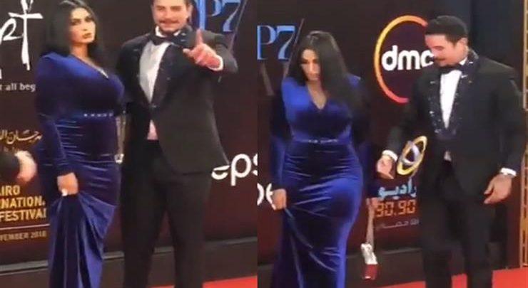 بالفيديو.. أحمد الفيشاوي وزوجته يخطفان الأضواء في مهرجان القاهرة السينمائي
